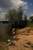 Amvrosiyivka, Ukraine.July 27, 2005 ..A child swims in the village lake....