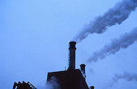 AVAILABLE FOR COMMERCIAL AND EDITORIAL LICENSING FROM GETTY IMAGES.  Please go to www.gettyimages.com and search for image # a0142-000110<br /> <br /> Electric Power Plant Smokestacks on an Overcast Day, New York City, New York State, USA