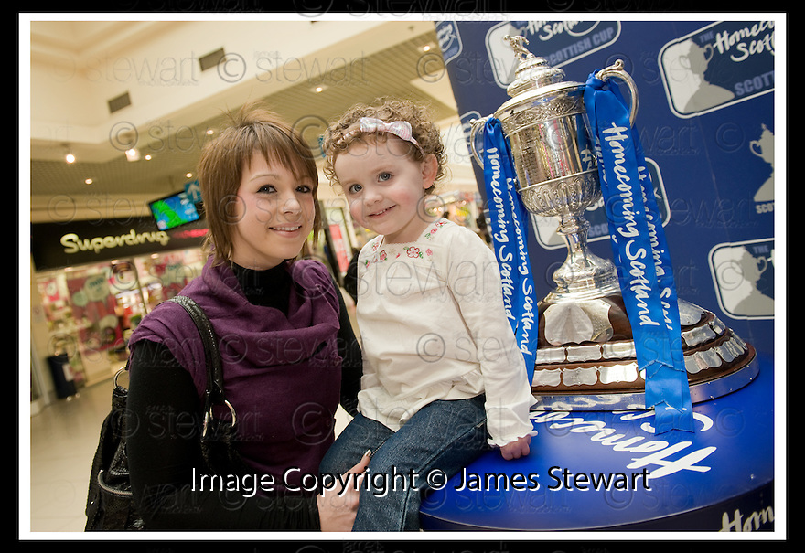 24/02/2009  Copyright Pic: James Stewart.File Name : sct_jspa23_scottis_cup.LAURA GRANT AND CARMEN JUDGE STOP TO HAVE A LOOK AT THE HOMECOMING SCOTLAND SCOTTISH CUP IN THE MALL SHOPPING CENTRE, FALKIRK, AS IT CONTINUES IT'S TOUR OF SCOTLAND.....Press Release..... A unique interactive tour to engage primary school children with football and the Homecoming Scottish Cup rolls into town today, Tuesday 24 February 2009 at St Margaret's Primary School in Falkirk.  . .Up to 100 pupils in primaries 5 to 7 at each local school will receive specialist skills and drill training from Scottish Football Association coaches as well as getting the chance to view the Homecoming Scottish Cup trophy itself.. .The school tour takes the form of a giant 'football-shaped' tent, which houses the world's oldest footballing trophy and information about Homecoming Scotland and the Scottish Cup tournament.. .Future football stars will be given soccer skills training ahead of watching their home team, Falkirk, take on Inverness Caledonian Thistle in the quarter finals of the Homecoming Scottish Cup on the weekend of 7 March.. .Falkirk legend Alex Totten, who used to manage the side, will be on hand at St Margaret's Primary School to share his knowledge and experience with the kids and to see the trophy himself.. .All primary schools in Scotland will also be sent education packs to encourage pupils to know more about Homecoming Scotland and to learn more about healthy eating, fitness and playing football as a way to keep fit and have fun.  . .As part of the football celebrations, the tour will then encourage locals in the town centre to get behind their local team, when the cup visits The Mall in Falkirk later in the afternoon.. .The Homecoming Scottish Cup Tour has been designed to engage with Scotland's local communities and spread the message about joining in the celebrations for Homecoming Scotland 2009, a programme comprising over 300 events to celebrate Scotland's culture, heritage and its