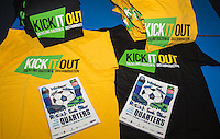Kick it Out shirts on display with Matchday programmes during the Sky Bet League 2 match between Wycombe Wanderers and Stevenage at Adams Park, High Wycombe, England on 12 March 2016. Photo by Andy Rowland/PRiME Media Images.