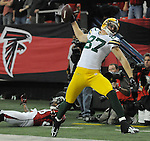 Green Bay Packers receiver Jordy Nelson spikes the ball near Atlanta Falcons' Thomas DeCoud during the fourth quarter of the game at the Georgia Dome in Atlanta, Ga., on Nov. 28, 2010.  Nelson scored a touchdown on a fourth down play.