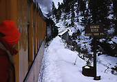 D&amp;SNG Cascade Canyon winter train about to cross Tacoma high bridge.  A sign says &quot;Animas River Elev. 7200 Ft.&quot;<br /> D&amp;S  Tacoma, CO