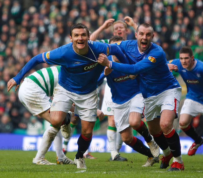 Lee McCulloch celebrates his goal with Kris Boyd as Celtic are distraught