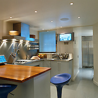 The high-tech kitchen has work surfaces of stainless steel and wood