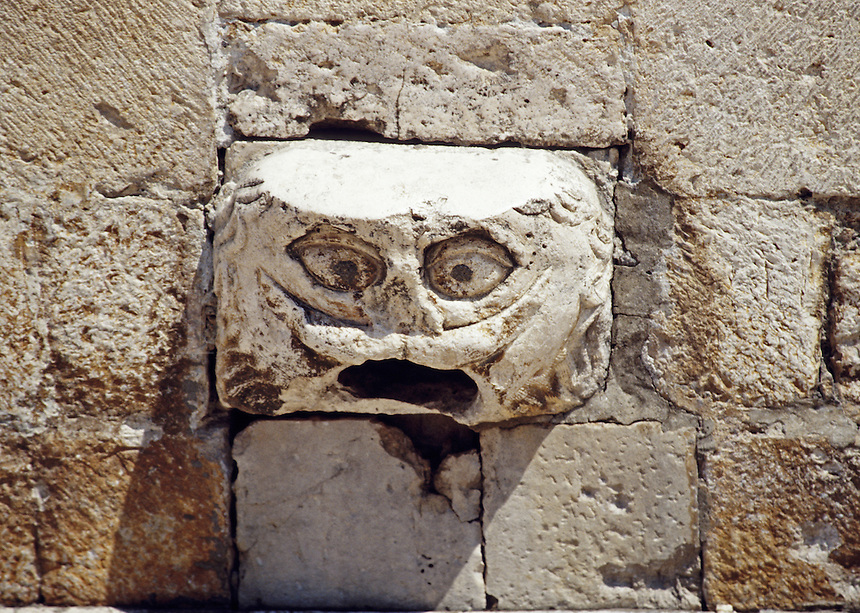 Rain spout as old man's face