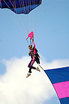 Aleth Matrone of Misty Blues all female jump team  prepares to land in the infield during the Rotary Festival at the Lycoming County Fairgrounds Saturday.