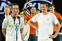 January 30, 2016: Daniel Nestor of Canada and Radek Stepanek of Czech Republic accept their runners' up trophy for the Men's Doubles against Jamie Murray of United Kingdom and Bruno Soares of Brazil on day thirteen of the 2016 Australian Open Grand Slam tennis tournament at Melbourne Park in Melbourne, Australia. Murray and Soares won 26 64 75. Photo Sydney Low