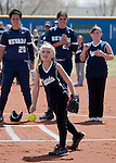 April 7, 2012:   A member of the Sparks fastpitch 10-under Wolf Pack team throws out the first pitch before the Nevada Wolf Pack versus San Jose State Spartans softball game played at Christina M. Hixson Softball Park on Saturday in Reno, Nevada.