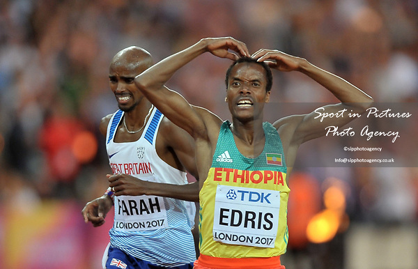 Muktar EDRIS (ETH) does the MOBOT as he wins the mens 5000m final, with Mo Farah (GBR) in the background. IAAF world athletics championships. London Olympic stadium. Queen Elizabeth Olympic park. Stratford. London. UK. 12/08/2017. ~ MANDATORY CREDIT Garry Bowden/SIPPA - NO UNAUTHORISED USE - +44 7837 394578