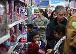 Local heroes shop with students at the 11th annual Holiday with a Hero at Walmart in Carson City, Nev., on Wednesday, Dec. 16, 2015. <br /> Photo by Cathleen Allison