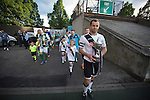 Edinburgh City captain Dougie Gair (right), holding the Lowland League trophy and Hibernian captain David Gray with the Scottish Cup, leading the teams on to the pitch before a pre-season friendly at Meadowbank Stadium. The match was City's first at the Commonwealth Stadium since they gained promotion from the Lowland League to the Scottish League in May 2016. A record crowd for a City match of 2500 spectators saw the visitors run out 6-1 winners.