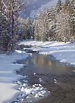 Okanogan County, WA<br /> Methow River flows with banks of fresh snow in the Methow Valley near Mazama