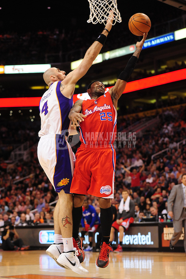 Mar. 2, 2012; Phoenix, AZ, USA; Los Angeles Clippers guard Mo Williams (25) takes a shot under pressure from Phoenix Suns center Marcin Gortat (4) at the US Airways Center. The Suns defeated the Clippers 81-78. Mandatory Credit: Mark J. Rebilas-USA TODAY Sports