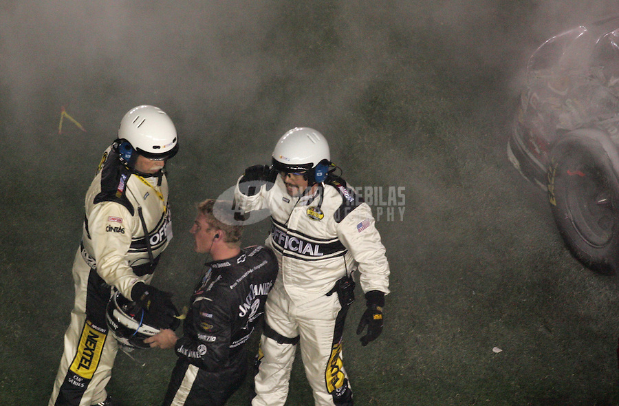 Feb 18, 2007; Daytona, FL, USA; Nascar Nextel Cup Series driver Clint Bowyer (07) is tended to by officials after flipping over on the last lap during the Daytona 500 at Daytona International Speedway. Mandatory Credit: Mark J. Rebilas