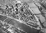 Pittsburgh PA: Aerial view of the city of Pittsburgh - 1929.  Brady Stewart took this photo after the completion of the new Grant and Kopper's buildings.  Image shows how the railroads weaved through and around the city during this time.