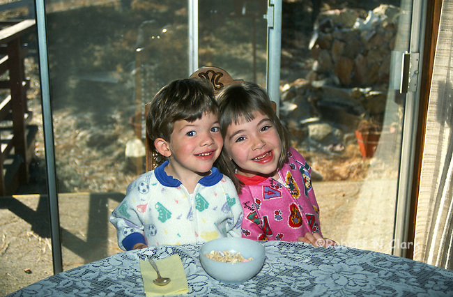 Boy and girl clowning with breakfast