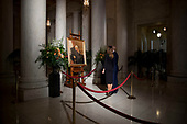 President Donald Trump and first lady Melania Trump stop to look at a painting of the late Supreme Court Justice John Paul Stevens as he lies in repose in the Great Hall of the Supreme Court in Washington, Monday, July 22, 2019. <br /> Credit: Andrew Harnik / Pool via CNP