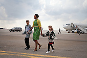First Lady Michelle Obama walks across the tarmac with Megan Soukup, 9, and Joseph Hudella, 10, participants in the Defending the Blue Line program, as she prepares to greet military families at Minneapolis-St. Paul International Airport in Minneapolis, Minnesota, March 16, 2012. The First Lady traveled to Minnesota to meet with National Guard families and local community leaders dedicated to supporting military families.  .Mandatory Credit: Sonya N. Hebert - White House via CNP