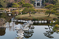 The trees are perfectly reflected in the still water of the lake at Suizen-ji garden, Kumamoto, Japan