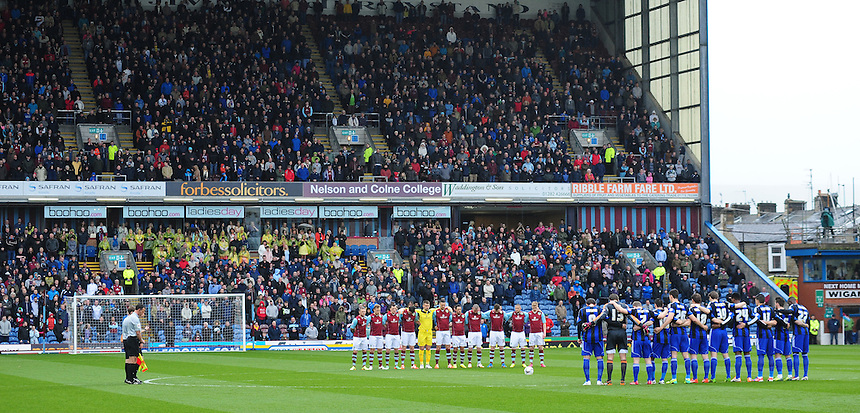 Players from Burnley and Middlesbrough observe a minutes silence for the 25th anniversary of the Hillsborough disaster<br /> <br /> Photo by Chris Vaughan/CameraSport<br /> <br /> Football - The Football League Sky Bet Championship - Burnley v Middlesbrough - Saturday 12th April 2014 - Turf Moor - Burnley<br /> <br /> &copy; CameraSport - 43 Linden Ave. Countesthorpe. Leicester. England. LE8 5PG - Tel: +44 (0) 116 277 4147 - admin@camerasport.com - www.camerasport.com