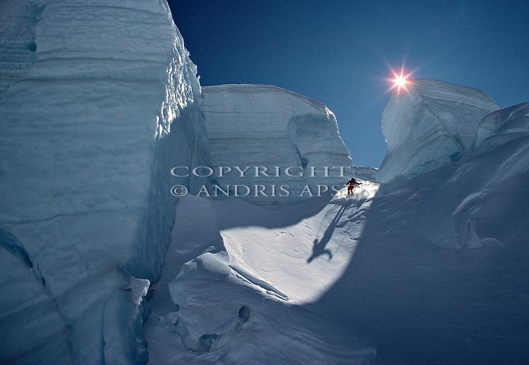 Skier on Tasman Glacier. Mount Cook National Park. New Zealand.