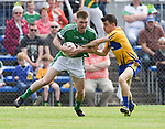 Seamus O Carroll of Limerick in action against Martin Mc Mahon of Clare during their Munster championship quarter-final game in Cusack park. Photograph by John Kelly.