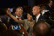 Washington, DC - January 2, 2015: Baltimore Mayor Stephanie Rawlings Blake takes a selfie with former D.C. mayors Anthony Williams (l) and Adrian Fenty (r) at the conclusion of the 2015 inauguration ceremony held at the Washington Convention Center, January 2, 2015.   (Photo by Don Baxter/Media Images International)