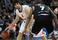 28.03.2012 Bilbao, Spain. Euroleague Playoff game 3. Picture show Milos Teodosic (L) and Aaron Jackson (R) in action  during match betwen Gescrap BB againts CSKA Moscow at Bilbao Arena