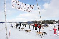 Sunday  March 7 , 2010   Ramey Smyth runs past spectators having a picnic on Long Lake during the re- start of the 2010 Iditarod in Willow , Alaska
