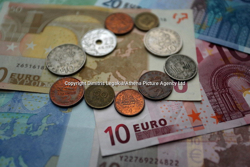A mixture of old drachma coins surrounding the map of Europe on a 50 euro paper note<br /> Re: The forthcoming elections in Greece has severely de-stabilised the currency and stock markets in Europe and the rest of the world.