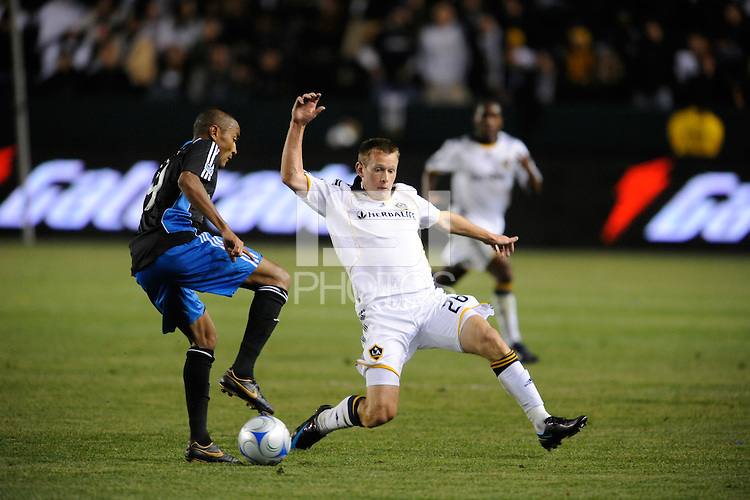 Los Angeles Galaxy's (26) Ely Allen can't get to  San Jose  Quakes (9) Gavin Gliton at the Home Depot Center in Carson, CA on Thursday, April 3, 2008..(Matt A. Brown)