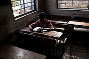 Students attend their classes in a government run school in Caregaon, Thane, Maharashtra. These schools run a specially designed concept of 'aflatoon' as part of the curriculam whereby students are made aware of their child as described in the convention of rights of child. These students are made aware of right to survival, right to protection, right to development and right to participation.