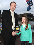 Aoife Smyth winner of the under 12 section of the RTE Local Heroes photo competition receives her prize from Tadhg Leonard representing sponsors  Nikon and Maher's Chemist. Photo: Colin Bell/pressphotos.ie