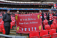 Liverpool fans hold up a banner that reads 'Liverpool F.C. If you Believe You Can Achieve' ahead of the Capital One Cup match between Liverpool and Manchester City at Wembley Stadium, London, England on 28 February 2016. Photo by David Horn / PRiME Media Images.