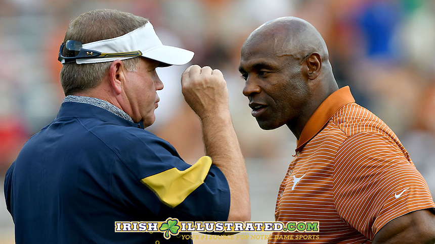 Head coach Brian Kelly and Texas Longhorns head coach Charlie Strong chat before the game.