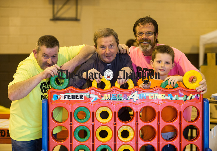 Committee members; Kevin Glynn and Fr Tommy Marron, PP with John and Johnathan O Sullivan of O Sullivan's Hotel, sponsors, playing Connect4 during the Gort Family Fun Day in Gort Community Centre. Photograph by John Kelly.