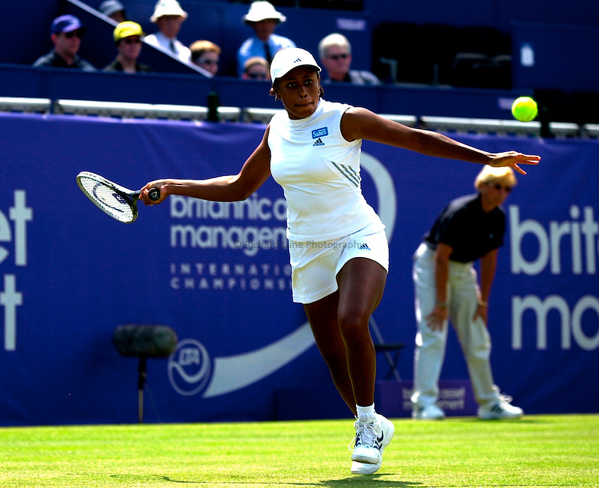 Photo. Rene Solari..22/6/01  .Eastbourne Day 5 (Semi-Finals).   Chanda Rubin returns the powerful serve from Lindsay Davenport...