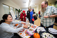 NWA Democrat-Gazette/JASON IVESTER <br /> JJ Cline (right) of Rogers purchases a pecan pie from Sahara Hoskins, Rogers Adult Wellness Center administrative assistant, on Wednesday, Nov. 25, 2015, at the center. Members and staff baked goods for the Holiday Pie &amp; Goodie Sale which raises funds for the center.
