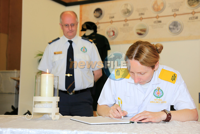 Members of the HSE Ambulance service signing the book of condolences to Gareth McGuirk who died after a swimming accident last week.<br /> Picture: www.newsfile.ie