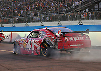 Nov. 9, 2008; Avondale, AZ, USA; NASCAR Sprint Cup Series driver Reed Sorenson after crashing during the Checker Auto Parts 500 at Phoenix International Raceway. Mandatory Credit: Mark J. Rebilas-