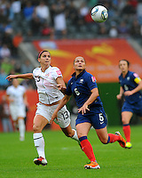 Alex Morgan (l) of team USA and Ophelie Meilleroux of team France during the FIFA Women's World Cup at the FIFA Stadium in Moenchengladbach, Germany on July 13th, 2011.