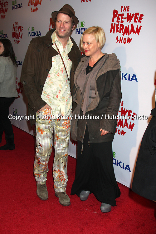 """Thomas Jane & Patricia Arquette.arriving at the """"The Pee Wee Herman Show"""" Opening Night..Club Nokia.Los Angeles, CA.January 20, 2010.©2010 Kathy Hutchins / Hutchins Photo...."""