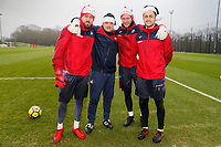 Pictured: Swansea City goalkeepers Kristoffer Nordfeldt, coach Tony Roberts, Erwin Mulder and Lukasz Fabianski players wearing Santa hats before training. Friday 22 December 2017<br /> Re: Swansea City FC training at Fairwood training ground, UK