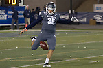 Nevada punter Quinton Conaway (35) kicks in the second half of an NCAA college football game New Mexico in Reno, Nev., Saturday, Nov. 2, 2019. (AP Photo/Tom R. Smedes)