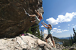 bouldering, woman on Sunspot, Chaos Canyon, sunny, day, summer, Rocky Mountain National Park, Rocky Mountains, Colorado, USA