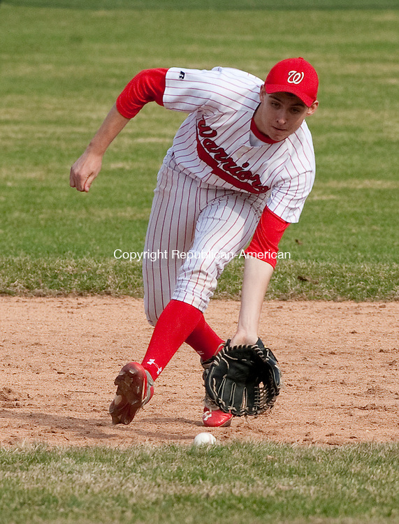 LITCHFIELD, CT-041414JS03-  Wamogo's Robert Whipple (24) fields a ground ball  during their Berkshire League game against Northwestern Monday at Wamogo High School in Litchfield. <br /> Jim Shannon Republican-American