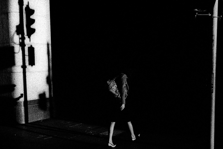 A woman walks between light and shade in Martin Place, Central Sydney, February 2007. Photo: Ed Giles.