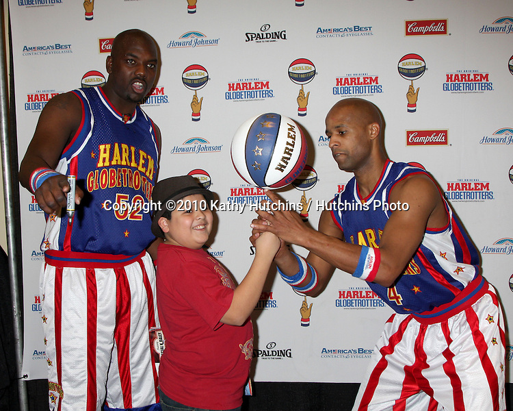 Big Easy, Rico Rodriguez, and Flight Time.at the Harlem Globetrotters Game .Staples Center.Los Angeles, CA.February 14, 2010.©2010 Kathy Hutchins / Hutchins Photo....