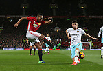 Luis Antonio Valencia of Manchester United crosses the ball past Aaron Cresswell of West Ham United during the Premier League match at the Old Trafford Stadium, Manchester. Picture date: November 27th, 2016. Pic Simon Bellis/Sportimage