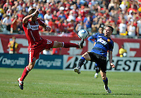 Chicago Fire defender Gonzalo Segares (13) goes for the ball in front of Manchester United Tom Cleverly (35).  Manchester United defeated the Chicago Fire 3-1 at Soldier Field in Chicago, IL on July 23, 2011.